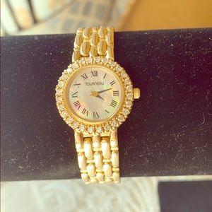 Tourneau 14K Ladies Gold watch with Diamonds